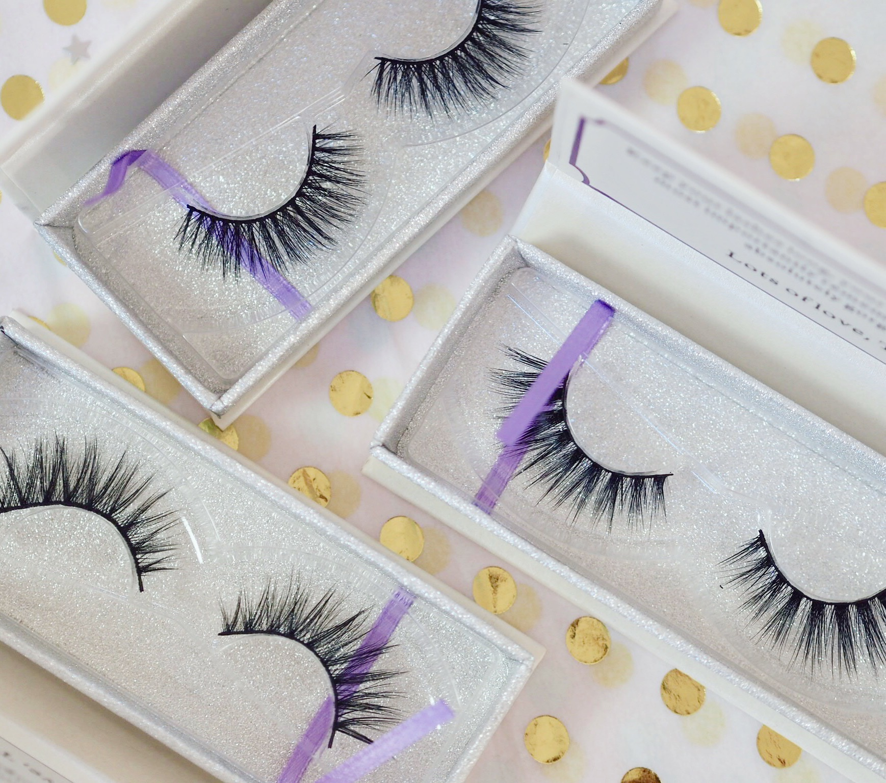 3 indigo rosee lashes on a gold background